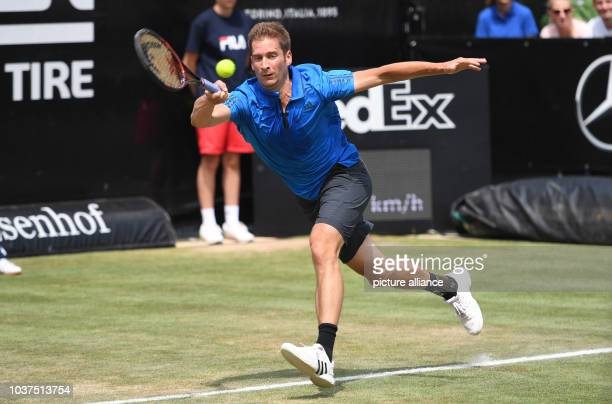 Florian Mayer from Germany in action against Federer from Switzerland during the quarterfinals of the ATP tournament at Weissenhof in Stuttgart...