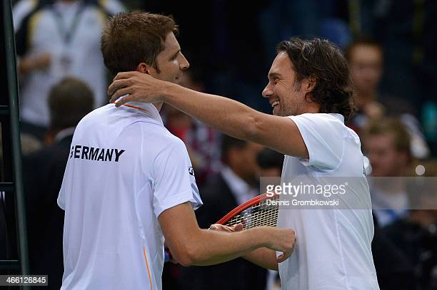 Florian Mayer of Germany and head coach Carsten Arriens hug on day 1 of the Davis Cup First Round match between Germany and Spain at Fraport Arena on...