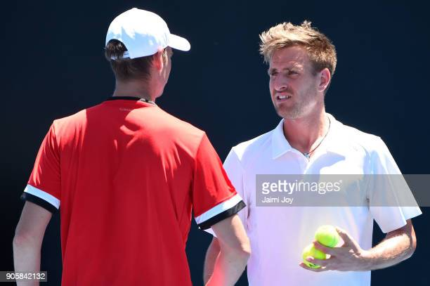 Florian Mayer of Germany and Peter Gojowczyk of Germany talk tactics in their first round men's doubles match against Artem Sitak of New Zealand and...