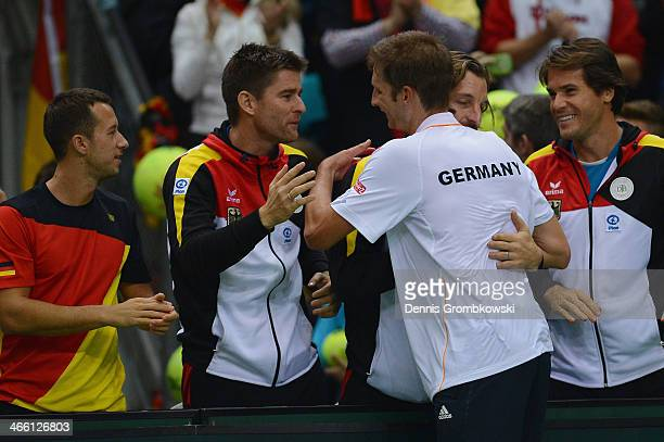 Florian Mayer of Germany celebrates after his match against Feliciano Lopez of Spain on day 1 of the Davis Cup First Round match between Germany and...