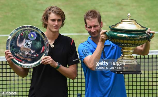 Florian Mayer of Germany celebrates after the match with his compatriot Alexander Zverev at the ATP tournament tennis final match in Halle western...