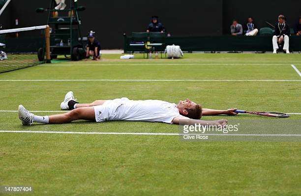 Florian Mayer of Germany celebrates match point during his Gentlemen's Singles fourth round match against Richard Gasquet of France on day eight of...