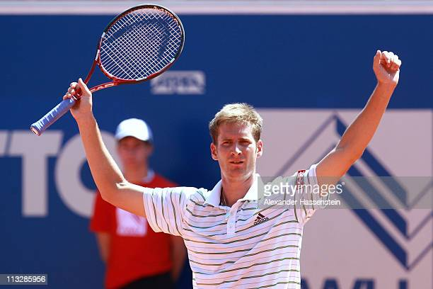 Florian Mayer of Germany celebrates victory after winning his semi final match against Philipp Petzschner of Germany at BMW Open at the Iphitos...