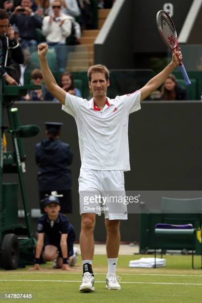 Florian Mayer of Germany celebrates winning his Gentlemen's Singles fourth round match against Richard Gasquet of France on day eight of the...
