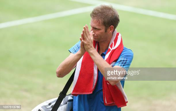 Florian Mayer of Germany cheers after his victory in the semifinal match against Thiem of Austria at the ATP tennis tournament in HalleGermany 18...