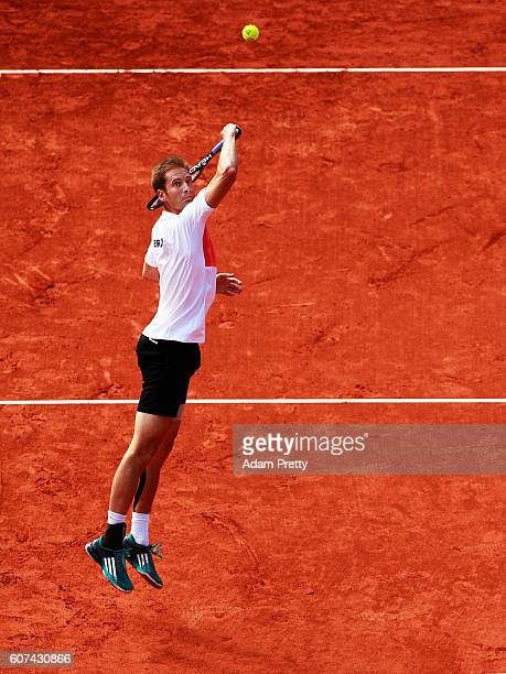 Florian Mayer of Germany jumps for a backhand smash during his match against of Kamil Majchrzak Poland during the 4th rubber of the Davis Cup Playoff...