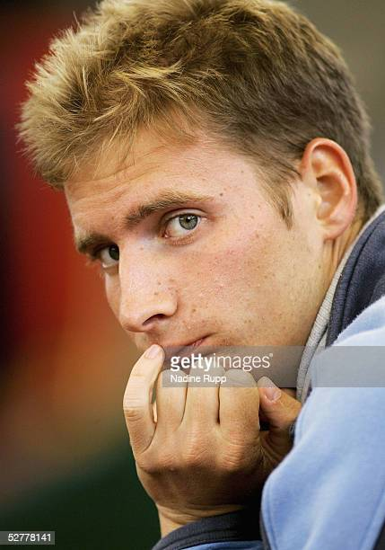 Florian Mayer of Germany looks on dejected after losing his match against Mario Ancic of Croatia during the Masters Series Hamburg at Rothenbaum on...