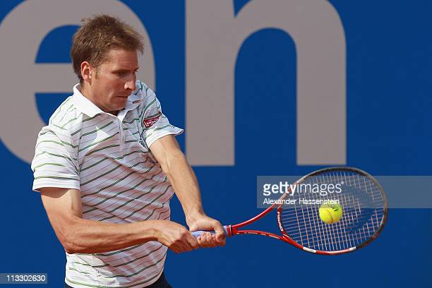 Florian Mayer of Germany plays a back hand during his final match against Nikolay Davydenko of Russia at BMW Open at the Iphitos tennis club on May 1...