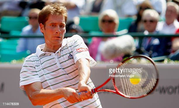 Florian Mayer of Germany plays a backhand during the final match between Florian Mayer of Germany and Juan Monaco of Argentina during day six of the...