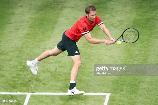 Florian Mayer of Germany plays a backhand to Yannick Maden of Germany during day 1 of the Mercedes Cup at Tennisclub Weissenhof on June 11, 2018 in...