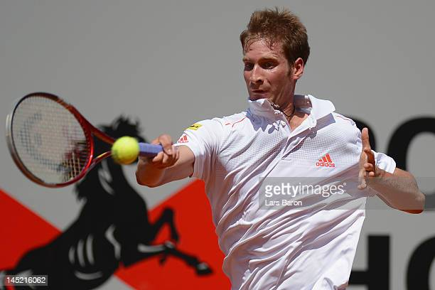 Florian Mayer of Germany plays a forehand during his match against Viktor Troicki of Serbia during day five of Power Horse World Team Cup at...