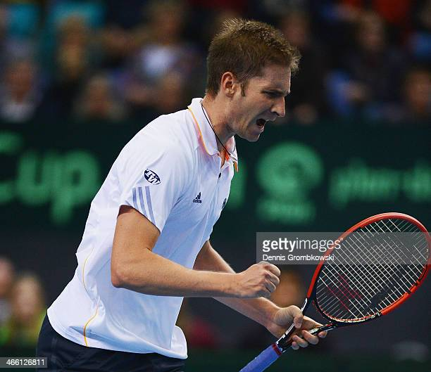 Florian Mayer of Germany reacts during his match against Feliciano Lopez of Spain on day 1 of the Davis Cup First Round match between Germany and...