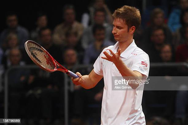 Florian Mayer of Germany reacts during his match against Juan Ignacio Chela of Argentina on day 3 of the Davis Cup World Group first round match...