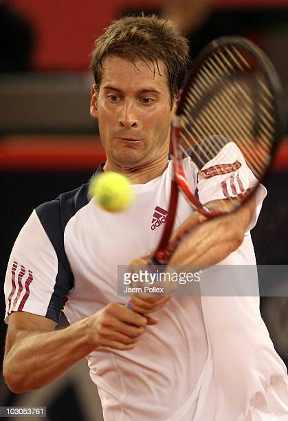 Florian Mayer of Germany returns a backhand during his Quarter Final match against Juan Carlos Ferrero of Spain during the International German Open...