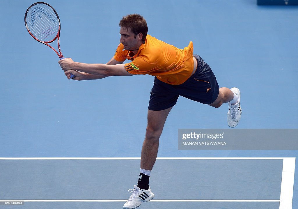Florian Mayer of Germany returns a shot against Bernard Tomic of Australia during their second round match at the Sydney International tennis tournament on January 9, 2013.