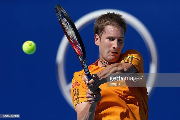 Florian Mayer of Germany returns a shot to Ze Zhang of China during the Day 7 of China Open at the China National Tennis Center on October 5 2012 in...