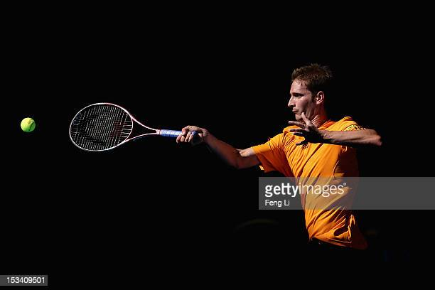 Florian Mayer of Germany returns a shot to Ze Zhang of China during the Men's Single Quarterfinal of China Open at the China National Tennis Center...