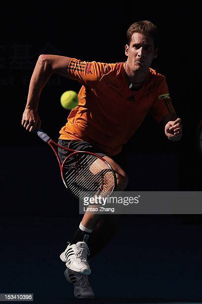 Florian Mayer of Germany returns a shot to Ze Zhang of China during the Quarterfinals of China Open at the China National Tennis Center on October 5...