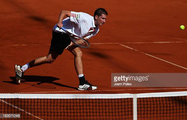 Florian Mayer of Germany returns the ball to Bernard Tomic of Australia during the Davis Cup World Group PlayOff match between Germany and Australia...