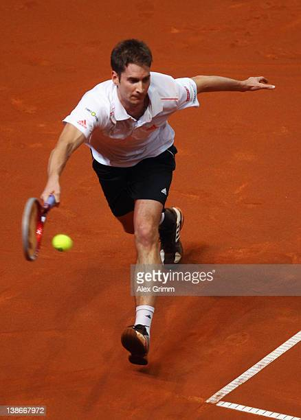 Florian Mayer of Germany returns the ball to David Nalbandian of Argentina during the Davis Cup World Group first round match between Germany and...