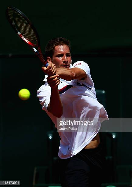 Florian Mayer of Germany returns the ball to Richard Gasquet of France during the quarterfinals match in the Davis Cup World Group at Tennis club...