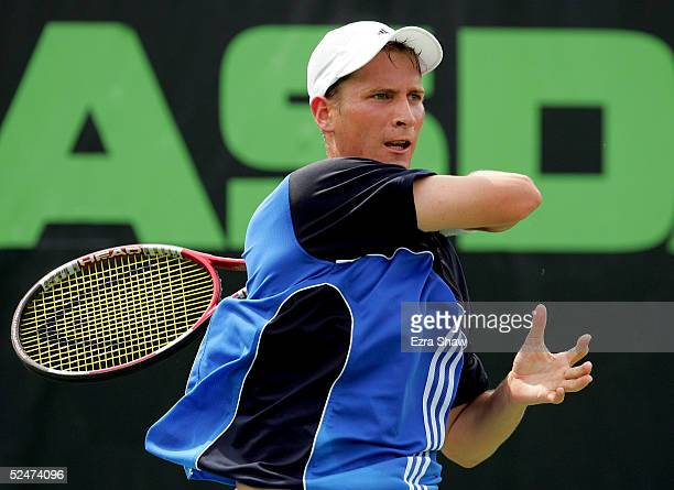 Florian Mayer of Germany returns to Lars Burgsmuller of Germany during the NASDAQ100 Open at the Crandon Park Tennis Center on March 24 2005 in Key...