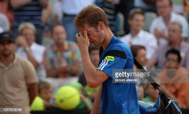 Florian Mayer of Germany rubs his eyes after losing in the second round match against Gael Monfils of France during the ATPTournament in Stuttgart...