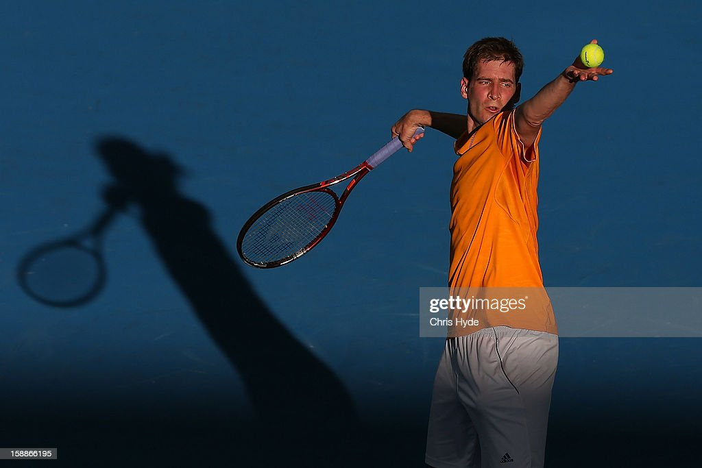Florian Mayer of Germany serves during his match against Marcos Baghdatis of Cyrpus on day four of the Brisbane International at Pat Rafter Arena on January 2, 2013 in Brisbane, Australia.