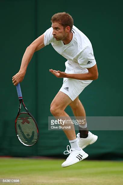 Florian Mayer of Germany serves during the Men's Singles first round match against Dominic Thiem of Austria on day three of the Wimbledon Lawn Tennis...