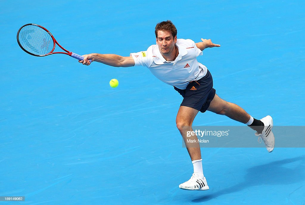 Florian Meyer of Germany plays a forehand in his second round match against Bernard Tomic of Australia during day four of the Sydney International at Sydney Olympic Park Tennis Centre on January 9, 2013 in Sydney, Australia.