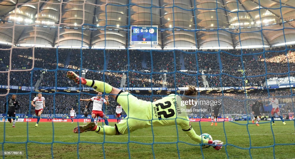 Florian Mueller of Mainz saves the penalty kick from Filip Kostic of Hamburg during the Bundesliga match between Hamburger SV and 1. FSV Mainz 05 at Volksparkstadion on March 3, 2018 in Hamburg, Germany.