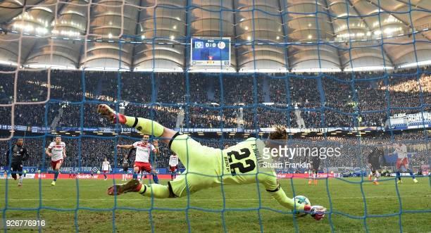 Florian Mueller of Mainz saves the penalty kick from Filip Kostic of Hamburg during the Bundesliga match between Hamburger SV and 1 FSV Mainz 05 at...
