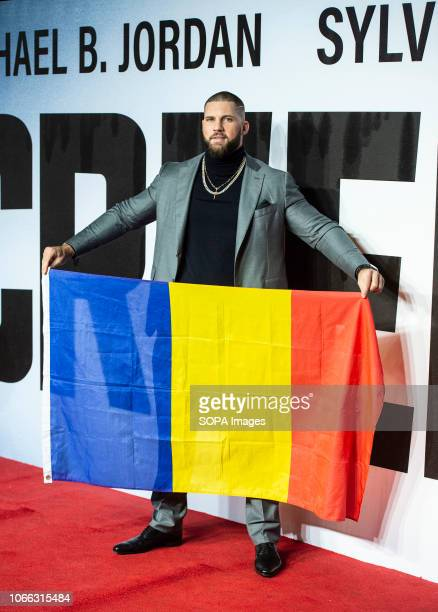 Florian Munteanu holds the Romanian flag as he attends the European Premiere of 'Creed II' at BFI IMAX