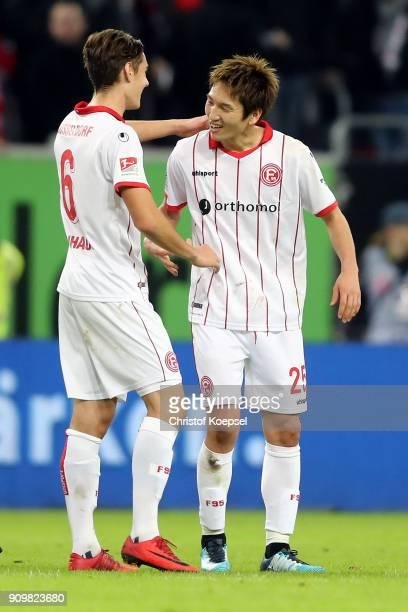 Florian Neuhaus and Genki Haraguchi of Duesseldorf celebrate after the Second Bundesliga match between Fortuna Duesseldorf and FC Erzgebirge Aue at...