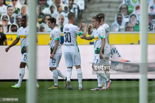 Florian Neuhaus and Nico Elvedi of Borussia Moenchengladbach celebrate the team's first goal during the Bundesliga match between Borussia...