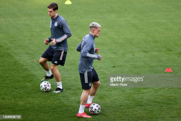 Florian Neuhaus and Philipp Max of Germany warm up during a training session at Schauinsland-Reisen-Arena on March 24, 2021 in Duisburg, Germany.