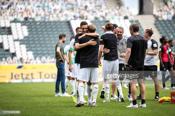 MOENCHENGLADBACH GERMANY JUNE Florian Neuhaus and Tony Jantschke of Borussia Moenchengladbach celebrate their win and Qualification for the Champions...