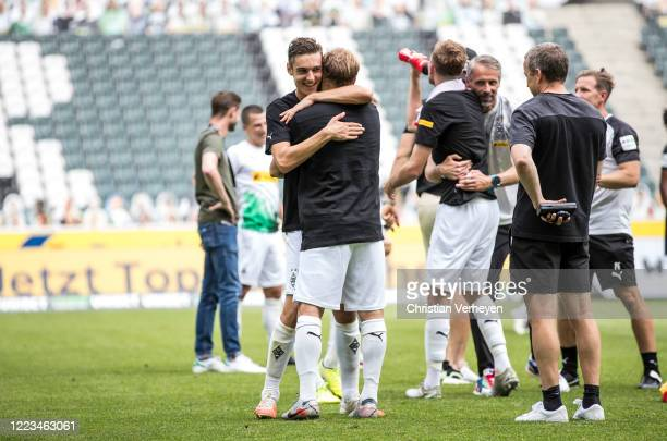 Florian Neuhaus and Tony Jantschke of Borussia Moenchengladbach celebrate their win and Qualification for the Champions League after the Bundesliga...