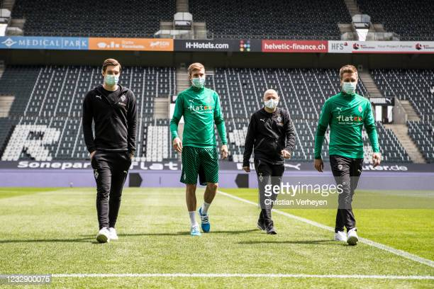 Florian Neuhaus, Christoph Kramer, Oliver Neuville and Patrick Herrmann of Borussia Moenchengladbach are seen before the Bundesliga match between...