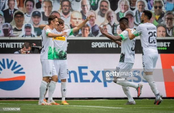 Florian Neuhaus Jonas Hofmann Breel Embolo and Ramy Bensebaini of Borussia Moenchengladbach celebrate after scoring the 10 during the Bundesliga...