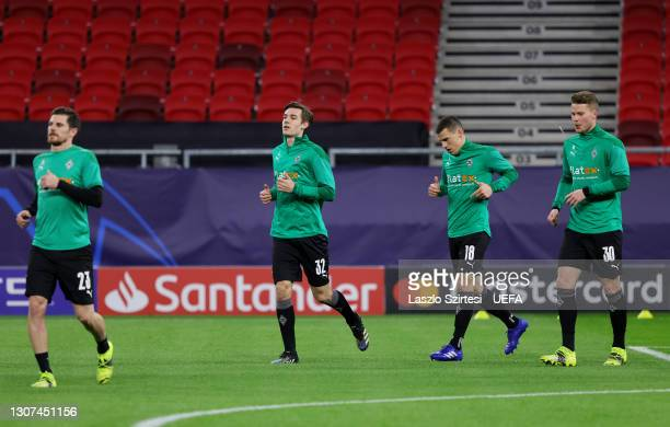 Florian Neuhaus, Laszlo Benes and Nico Elvedi of Borussia Moenchengladbach warm up prior to the UEFA Champions League Round of 16 match between...