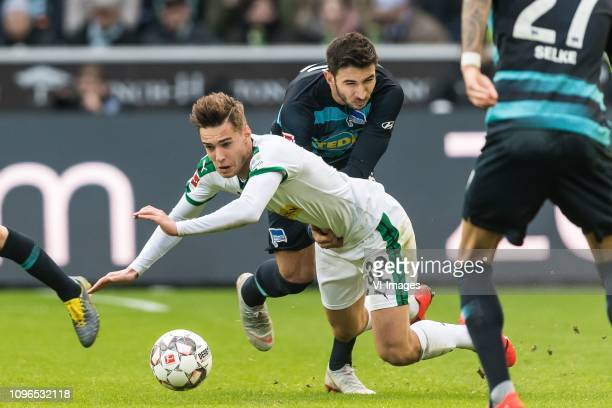 Florian Neuhaus of Borussia Mönchengladbach Marko Grujic of Hertha BSC DFL regulations prohibit any use of photographs as image sequences and/or...