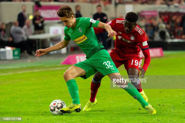 Florian Neuhaus of Borussia Moenchengladbach and Alphonso Davies of Bayern Muenchen battle for the ball during the Telekom Cup 2019 Final between FC...