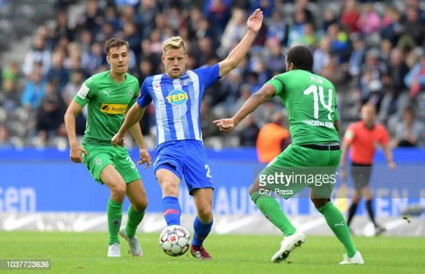 Florian Neuhaus of Borussia Moenchengladbach and Arne Maier of Hertha BSC and Alassane Pléa of Borussia Moenchengladbach during the game between...