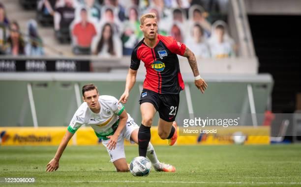 Florian Neuhaus of Borussia Moenchengladbach and Arne Maier of Hertha BSC during the Bundesliga match between Borussia Moenchengladbach and Hertha...