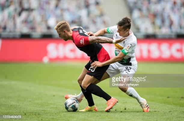 Florian Neuhaus of Borussia Moenchengladbach and Arne Maier of Hertha BSC battle for the ball during the Bundesliga match between Borussia...