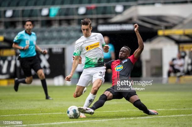 Florian Neuhaus of Borussia Moenchengladbach and Dodi Lukebakio of Hertha BSC battle for the ball during the Bundesliga match between Borussia...