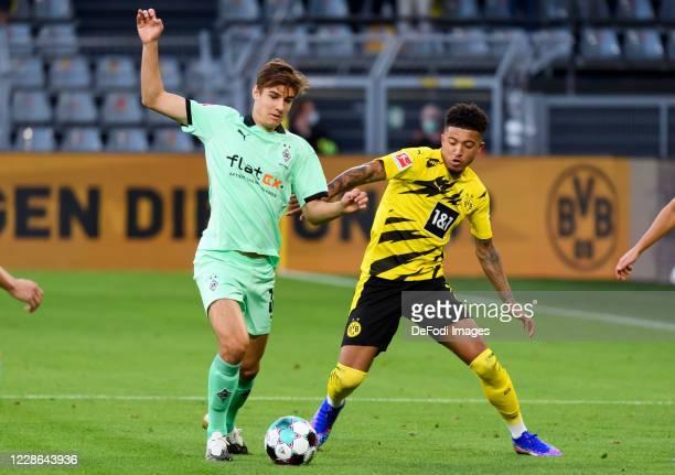 Florian Neuhaus of Borussia Moenchengladbach and Jadon Sancho of Borussia Dortmund battle for the ball during the Bundesliga match between Borussia...
