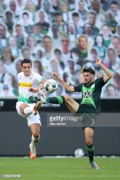 Florian Neuhaus of Borussia Moenchengladbach and Josip Brekalo of VfL Wolfsburg compete for the ball during the Bundesliga match between Borussia...