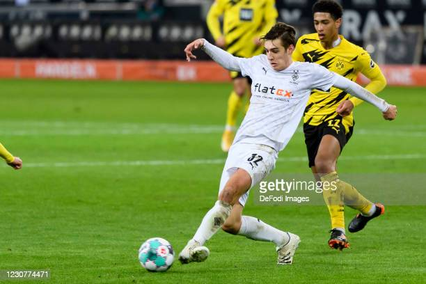 Florian Neuhaus of Borussia Moenchengladbach and Jude Bellingham of Borussia Dortmund battle for the ball during the Bundesliga match between...